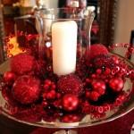 red glittery balls and white candle